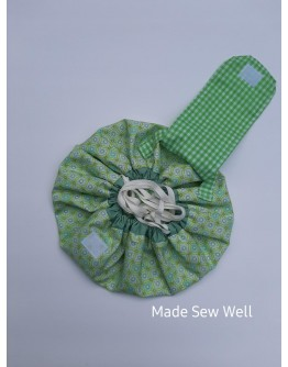 Drawstring Travel Pouch - Green grid with circles